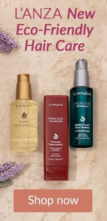 L'ANZA products arranged on stone counter. Shop LovelySkin for L'ANZA new eco-friendly hair care.